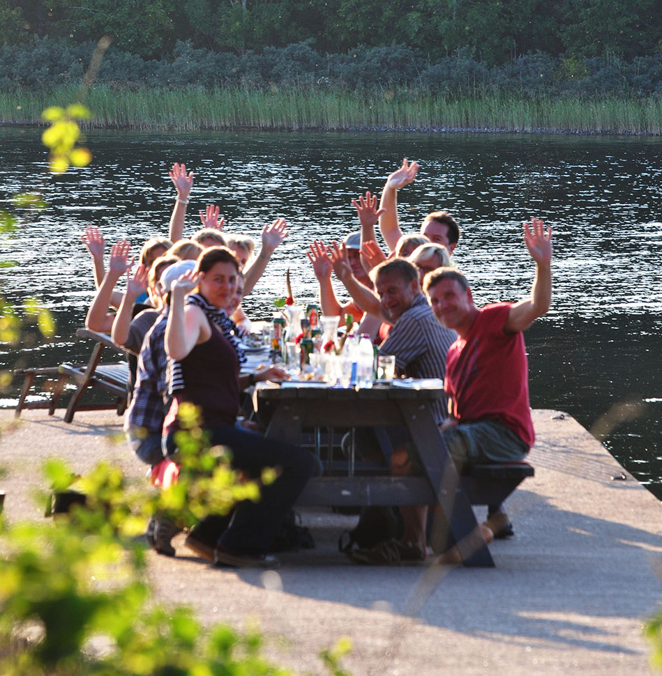 International ecotourism dining on the pier of Sågarbo Herrgård